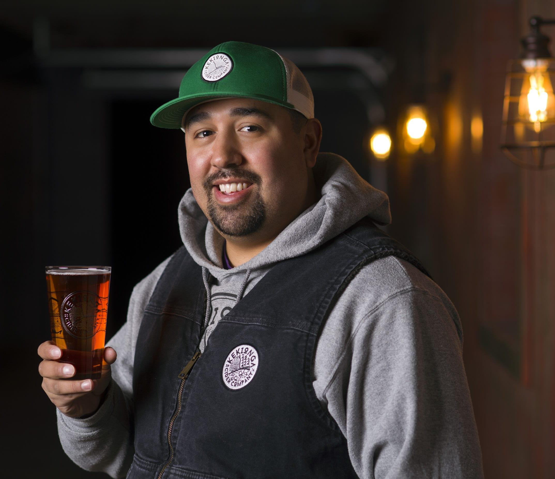 Kekionga Cider Company | Logan Barger holding craft beer cider