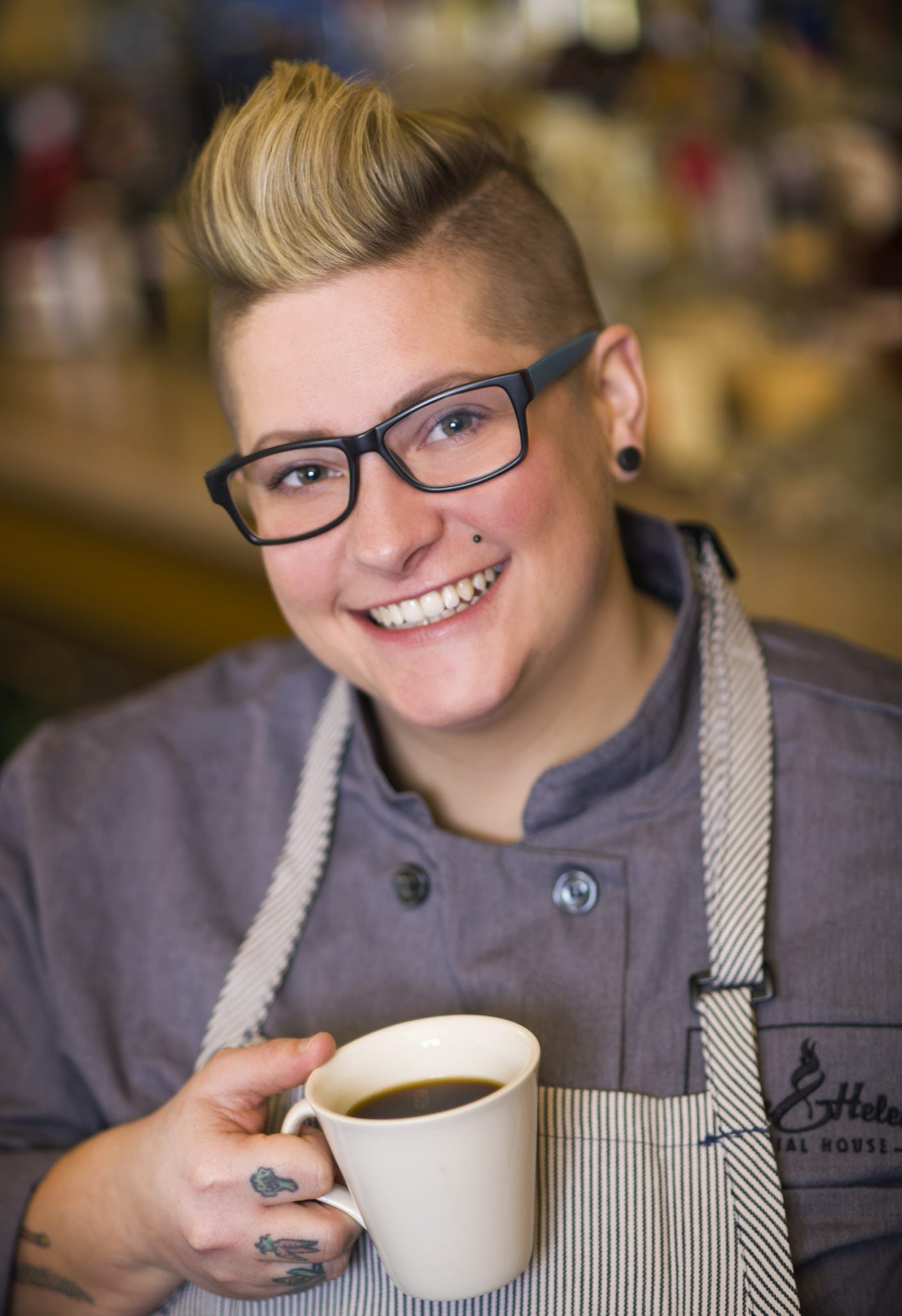 Maria Wunderlin, executive chef at Rack & Helen's Social House Fort Wayne holding a cup of coffee